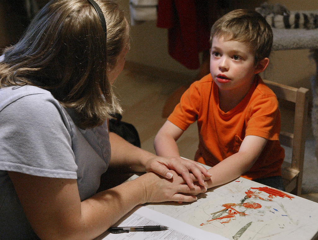 A therapist works with an autistic boy in Lacey, Washington.