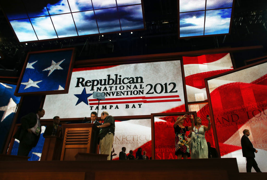 Wisconsin Gov. Scott Walker (C) stands at the podium ahead of the Republican National Convention at the Tampa Bay Times Forum on August 26, 2012 in Tampa, Florida.