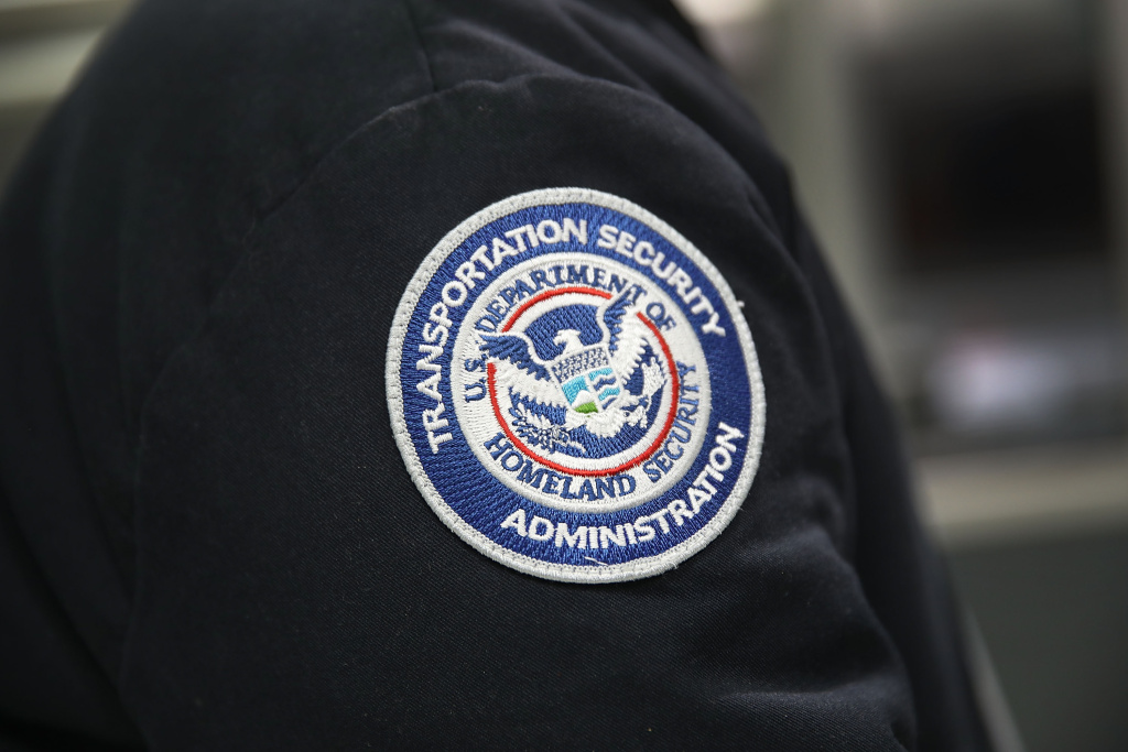 A patch is seen on the jacket of a Transportation Security Administration official at Miami International Airport on October 24, 2017 in Miami, Florida.