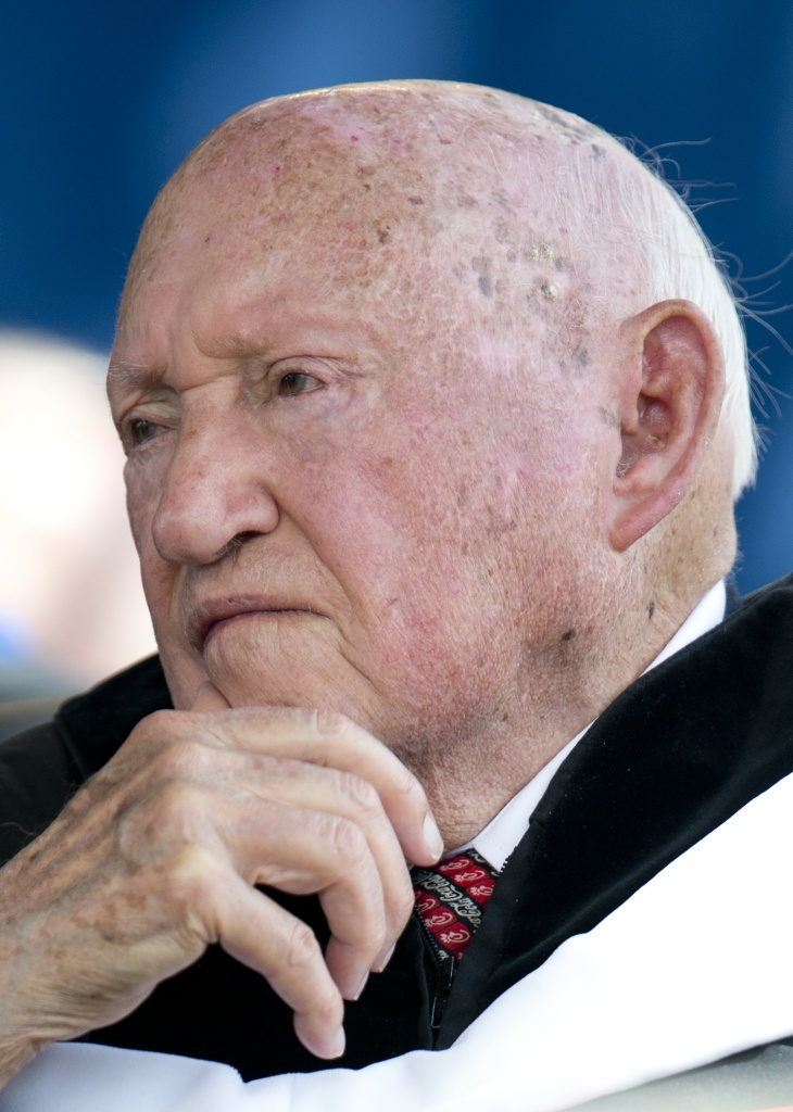 Chick-fil-A founder and Chairman S.Truett Cathy listens during the keynote address delivered by US Republican presidential hopeful Mitt Romney at Liberty University's 39th Annual Commencement in Lynchburg, Virginia, May 12, 2012.