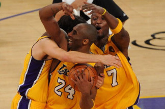 Kobe Bryant #24, Lamar Odom #7 and Sasha Vujacic #18 of the Los Angeles Lakers celebrate after winning the 2010 NBA Championship 83-79 against the Boston Celtics in Game Seven of the 2010 NBA Finals at Staples Center on June 17, 2010 in Los Angeles, California.
