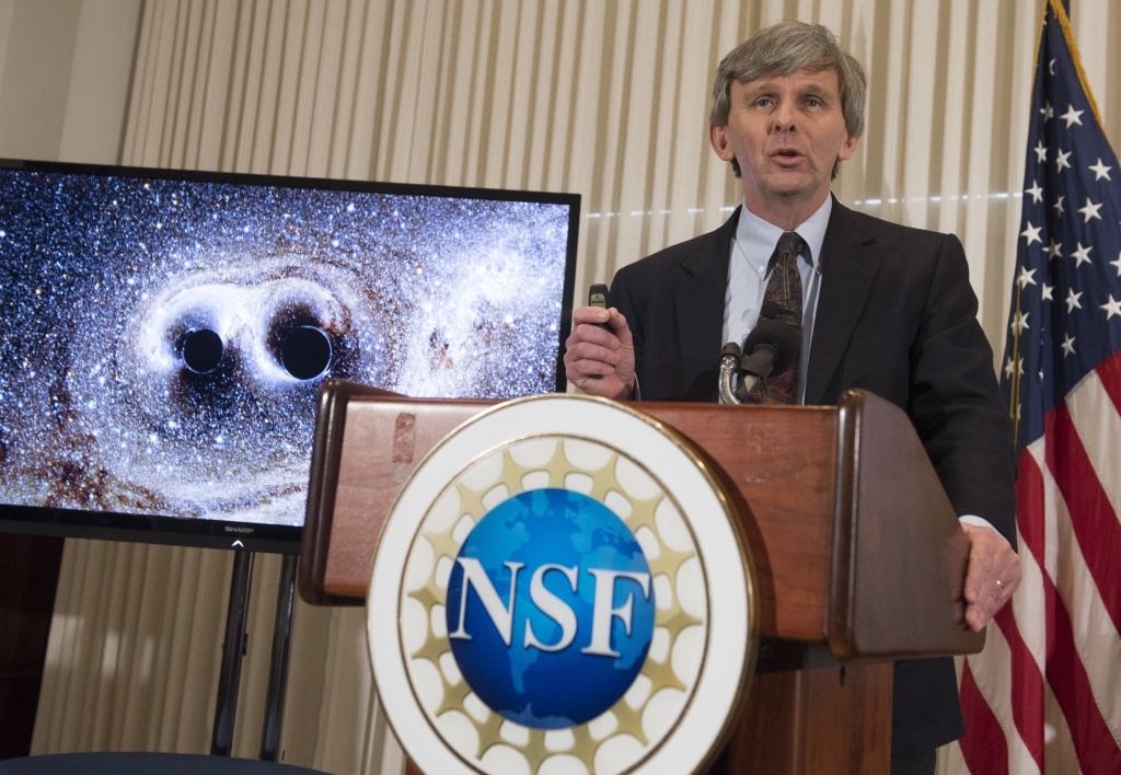 David Reitze, executive director of the LIGO Laboratory at Caltech, announces that scientists have observed ripples in the fabric of spacetime called gravitational waves for the first time, confirming a prediction of Albert Einstein's theory of relativity, during a press conference at the National Press Club in Washington, DC, February 11, 2016. The machines that gave scientists their first-ever glimpse at gravitational waves are the most advanced detectors ever built for sensing tiny vibrations in the universe.The two US-based underground detectors are known as the Laser Interferometer Gravitational-wave Observatory, or LIGO for short.  / AFP / SAUL LOEB        (Photo credit should read SAUL LOEB/AFP/Getty Images)