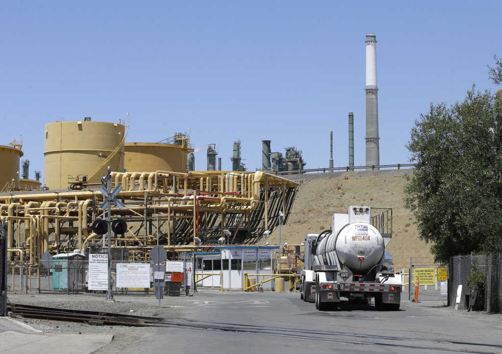 A truck drives into the Valero Benicia Refinery in Benicia. The state's cap-and-trade program puts a price on carbon emitted by polluters, including oil refineries.