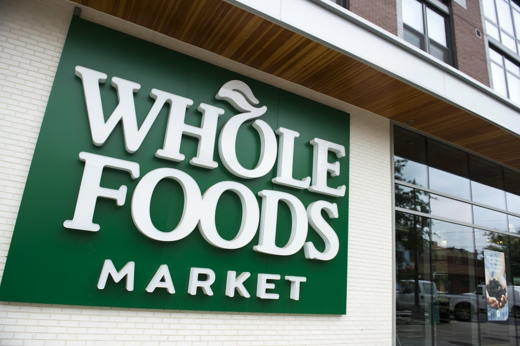 A Whole Foods Market sign is seen in Washington, DC, June 16, 2017, following the announcement that Amazon would purchase the supermarket chain for $13.7 billion.