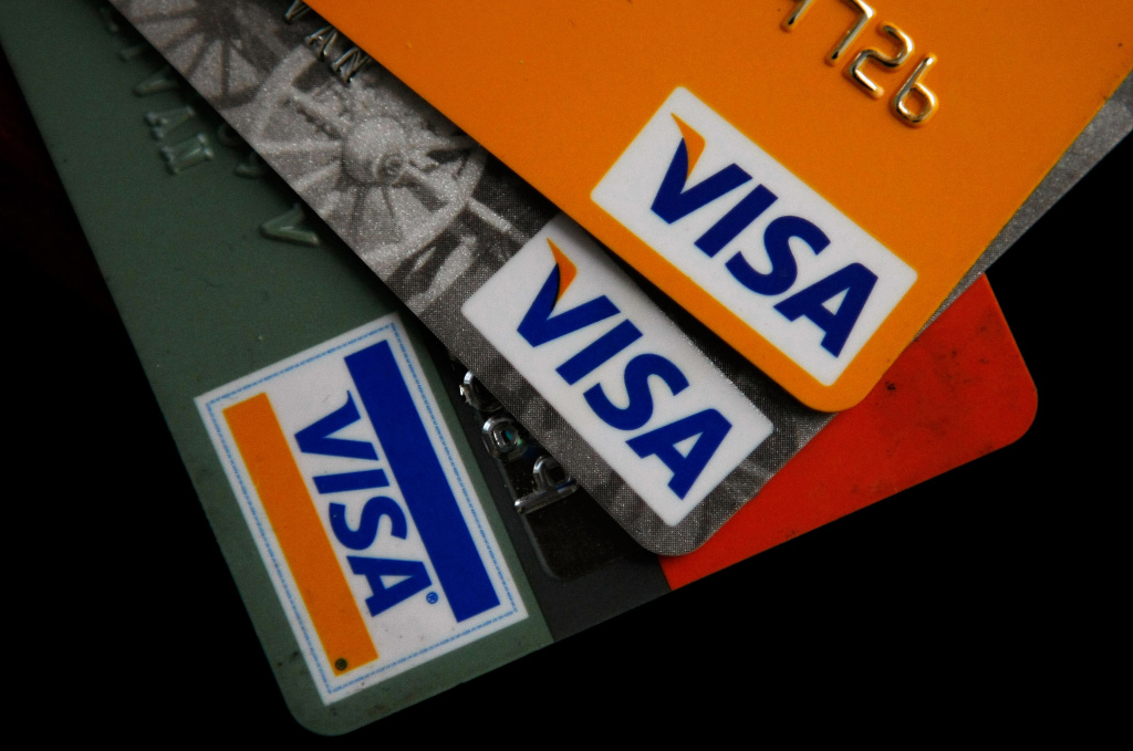 Visa credit cards are arranged on a desk February 25, 2008 in San Francisco, California