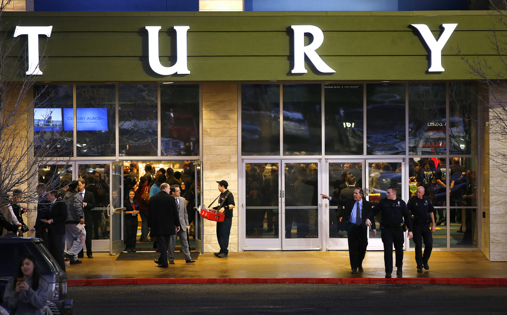 Guests make their way into a reopening ceremony and evening of remembrance at the Cinemark Century 16 Theaters in January, 2013 in Aurora, Colorado. The theater was the site of a mass shooting on July 20, 2012 that killed 12 people and wounded dozens of others.