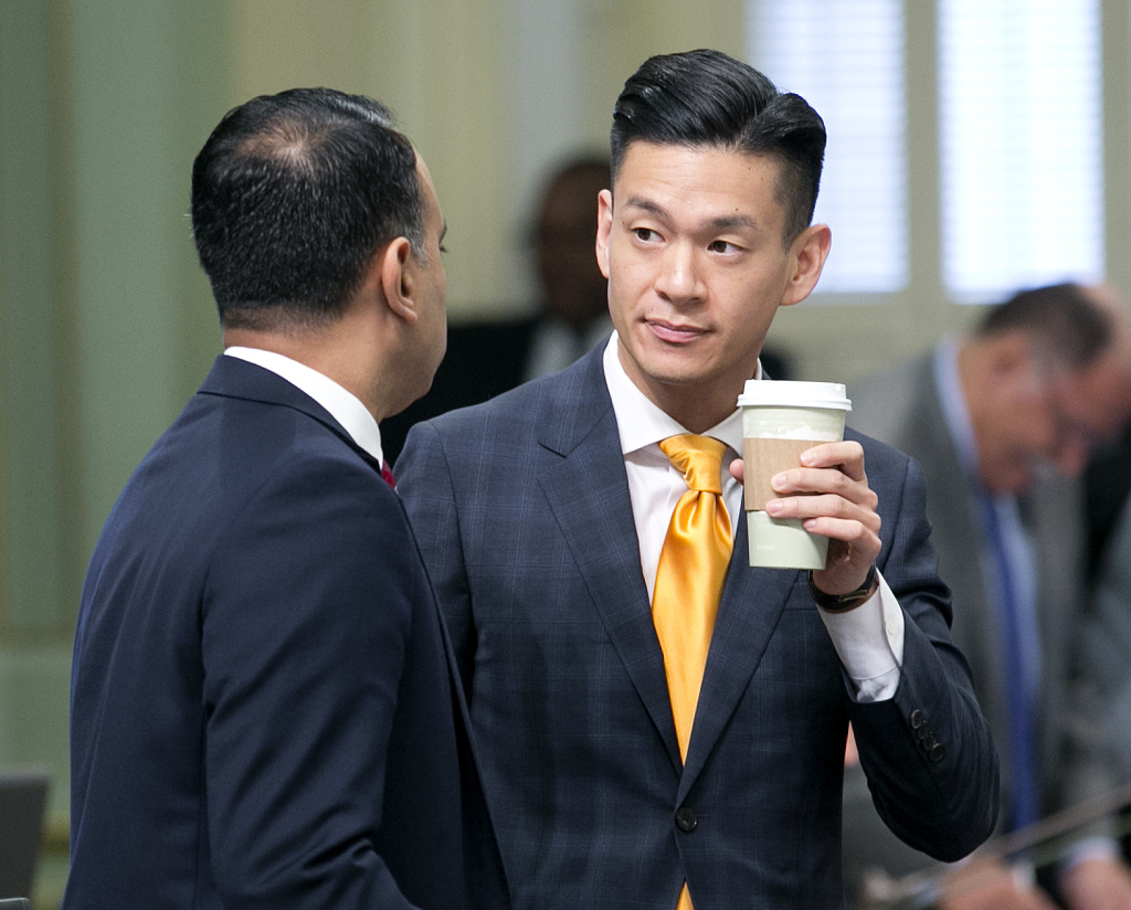 Assemblyman Ash Kalra, D-San Jose, left, talks with fellow Democratic Assemblyman Evan Low, of Campbell, at the Capitol Wednesday, Sept. 13, 2017, in Sacramento, Calif.