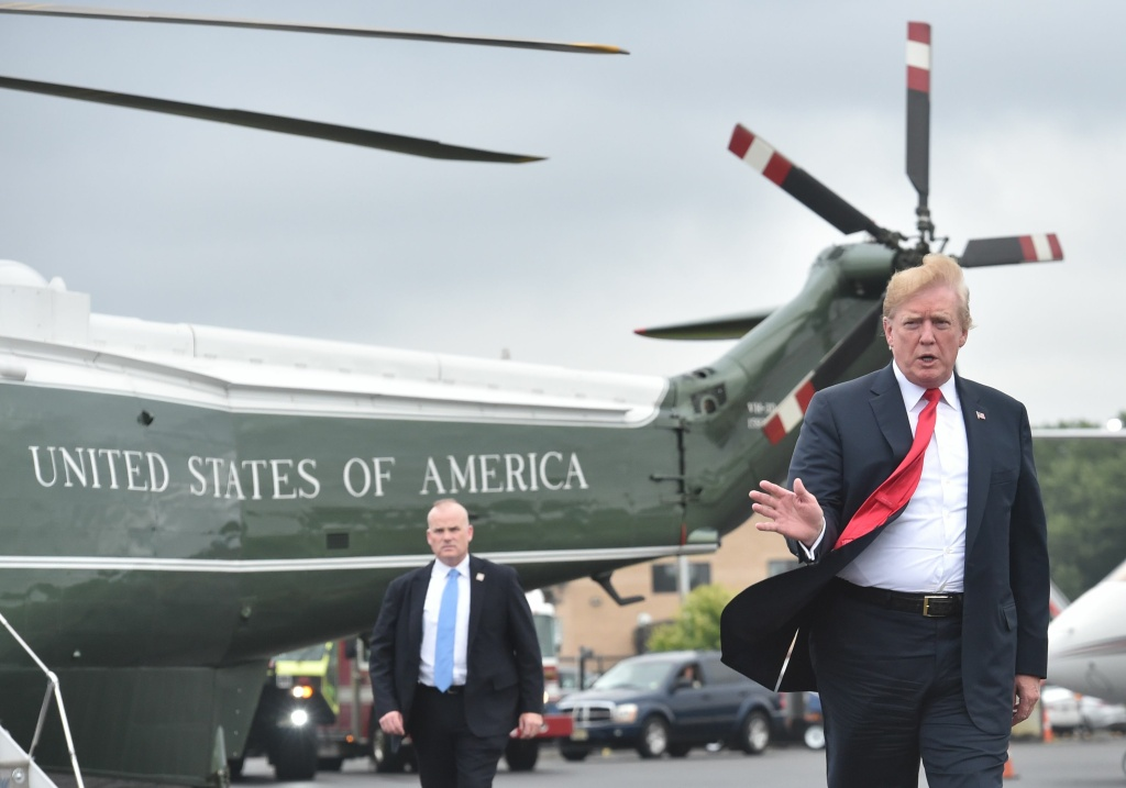 US President Donald Trump prepares to board Air Force One at Morristown Airport in Morristown, New Jersey, on July 22, 2018.