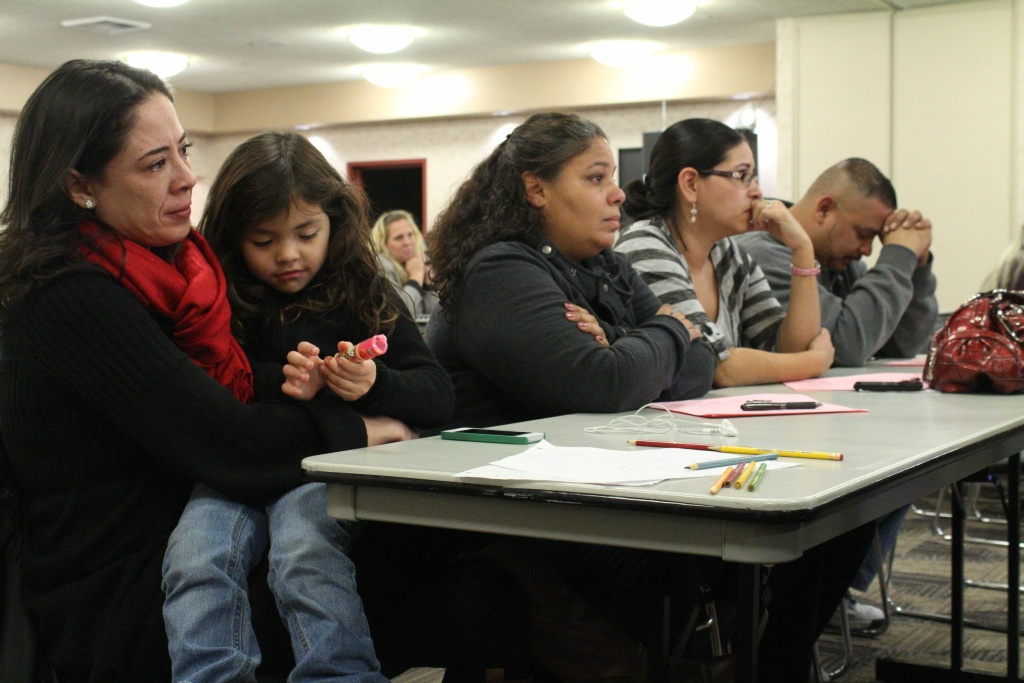 Parents and organizers who led the parent trigger campaign at Desert Trails Elementary School in Adelanto, Calif., await a decision from their school board about their petition for a charter school conversion in January 2013.