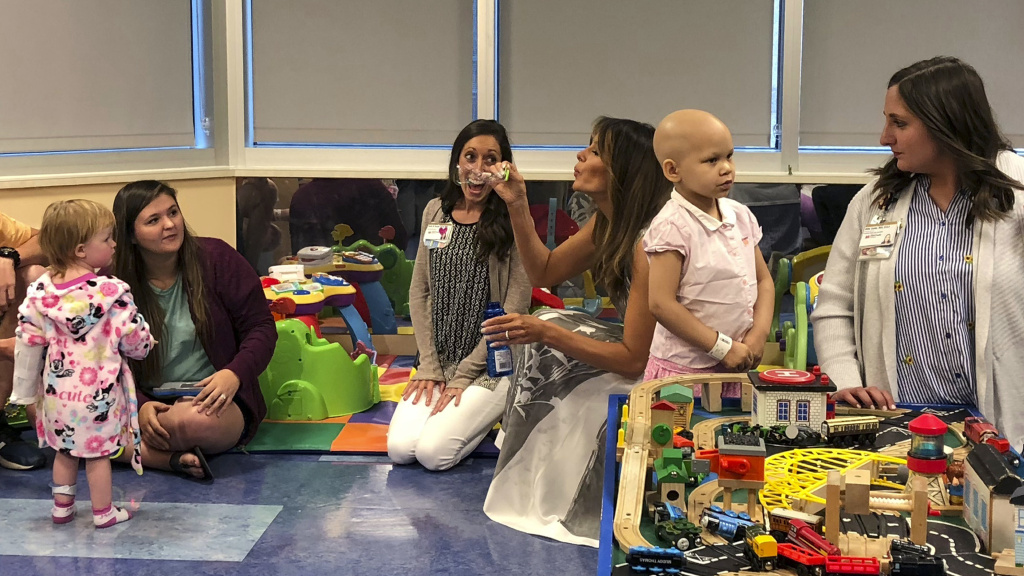 Melania Trump blows bubbles in a playroom with children during a visit to Monroe Carell Jr. Children's Hospital in Nashville, Tenn., on Tuesday. The first lady was promoting her