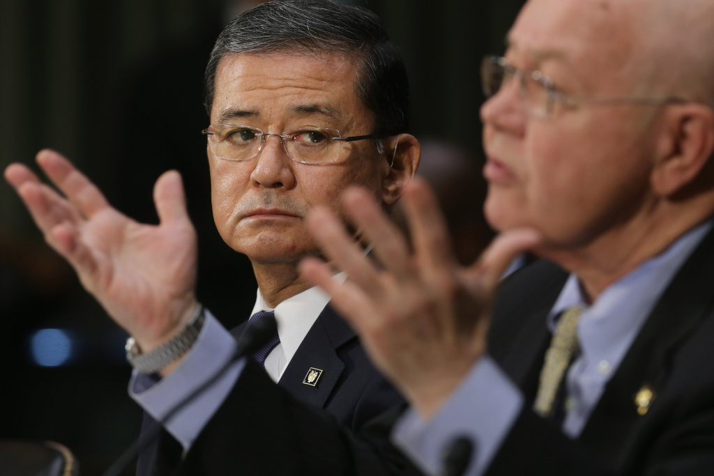 U.S. Veterans Affairs Secretary Eric Shinseki (L) and Veterans Affairs Undersecretary for Health Robert Petzel testify before the Senate Veterans' Affairs Committee about wait times veterans face  to get medical care May 15, 2014 in Washington, DC.