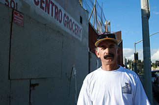 Truck driver George Del Rio stands in front of the El Centro grocery store. Del Rio, who grew up in the area, said he heard stories of the Nishiyamas, longtime operators of the store and the adjacent handball court, lending people money to pay rent or buy medicine for their sick children.