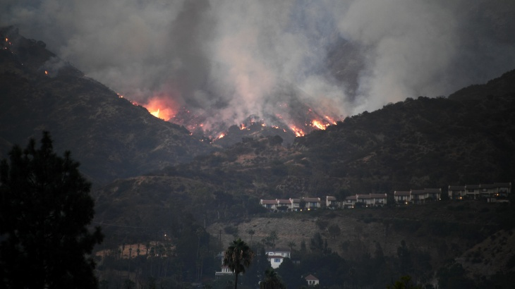 A Super Scooper CL-415 firefighting aircraft from Canada makes a drop to protect a house during the La Tuna Fire on September 3, 2017 near Burbank, California. At nearly 6,000 acres, the fire is the biggest fire in terms of acreage in Los Angeles city history. About 100 Los Angles firefighters are expected to return soon from Texas, where they've been helping survivors from Hurricane Harvey.