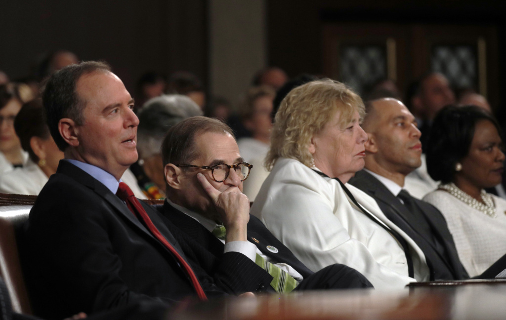 U.S. House impeachment managers Adam Schiff (D-CA) and Jerry Nadler (D-NY) listen to President Donald Trump deliver the State of the Union address in the House chamber on February 4, 2020 in Washington, DC.