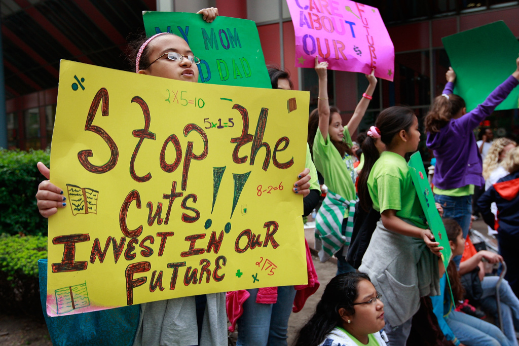 Children protest against proposed budgets cut that would slash funding to many social services organizations June 16, 2009 in Chicago, Illinois. Illinois Gov. Pat Quinn has threatened massive cuts in funding to these agencies if legislative leaders fail to pass a hefty income-tax increase.