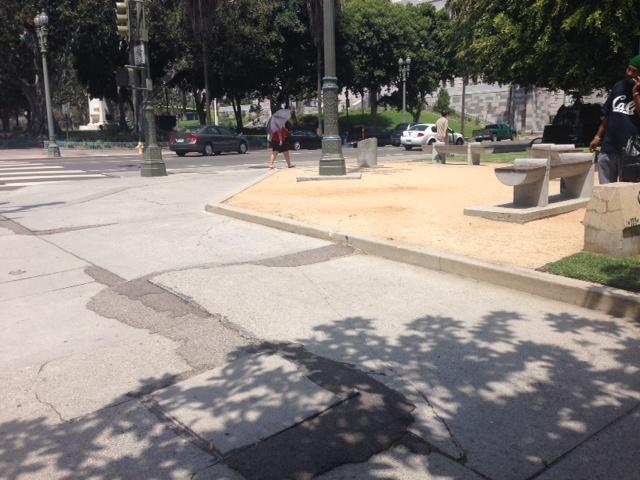 A broken sidewalk outside of Los Angeles City Hall.