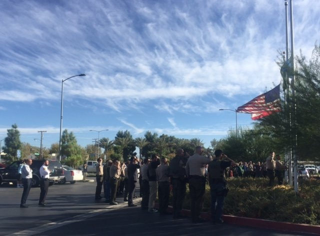 Los Angeles County Sheriff's Deputies salute Antelope Valley Hospital's lowering of the U.S. flag to half-staff on Wednesday, Oct. 5, 2016, in memory of Sheriff's Sgt. Steve Owen, who died at the hospital after being shot earlier in the day by a suspected burglar.