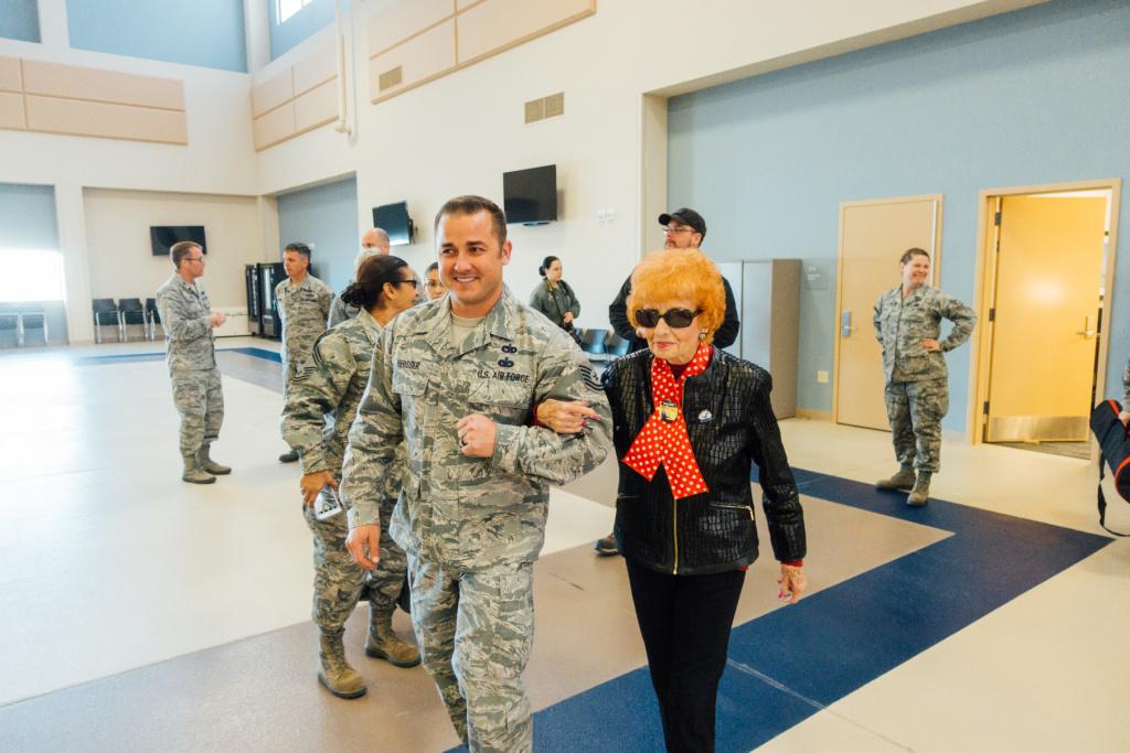 Elinor Otto is escorted to a waiting C-17 Globemaster III.