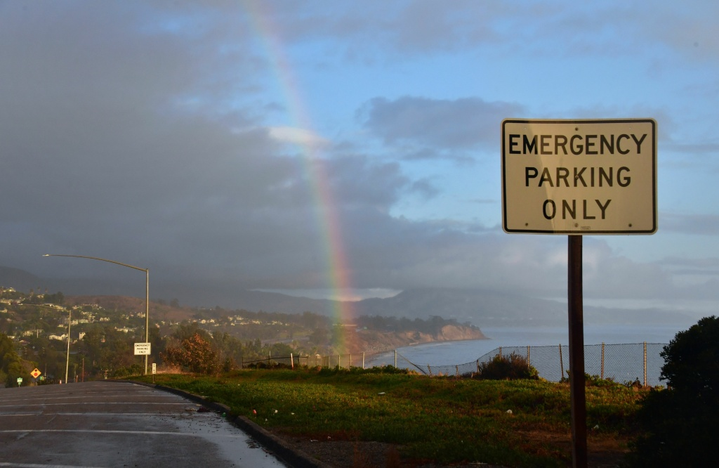 A rainbow appears on the coastline near Carpinteria after a night of heavy rain causing mudslides unleashed by a ferocious storm in this January 9, 2018 file photo. With a new winter storm coming this week, authorities have issued a recommended evacuation warning for the communities that were impacted by the mudslides.