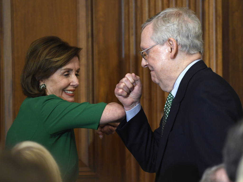 House Speaker Nancy Pelosi and Senate Majority Leader Mitch McConnell bump elbows on Capitol Hill on March 12, 2020.