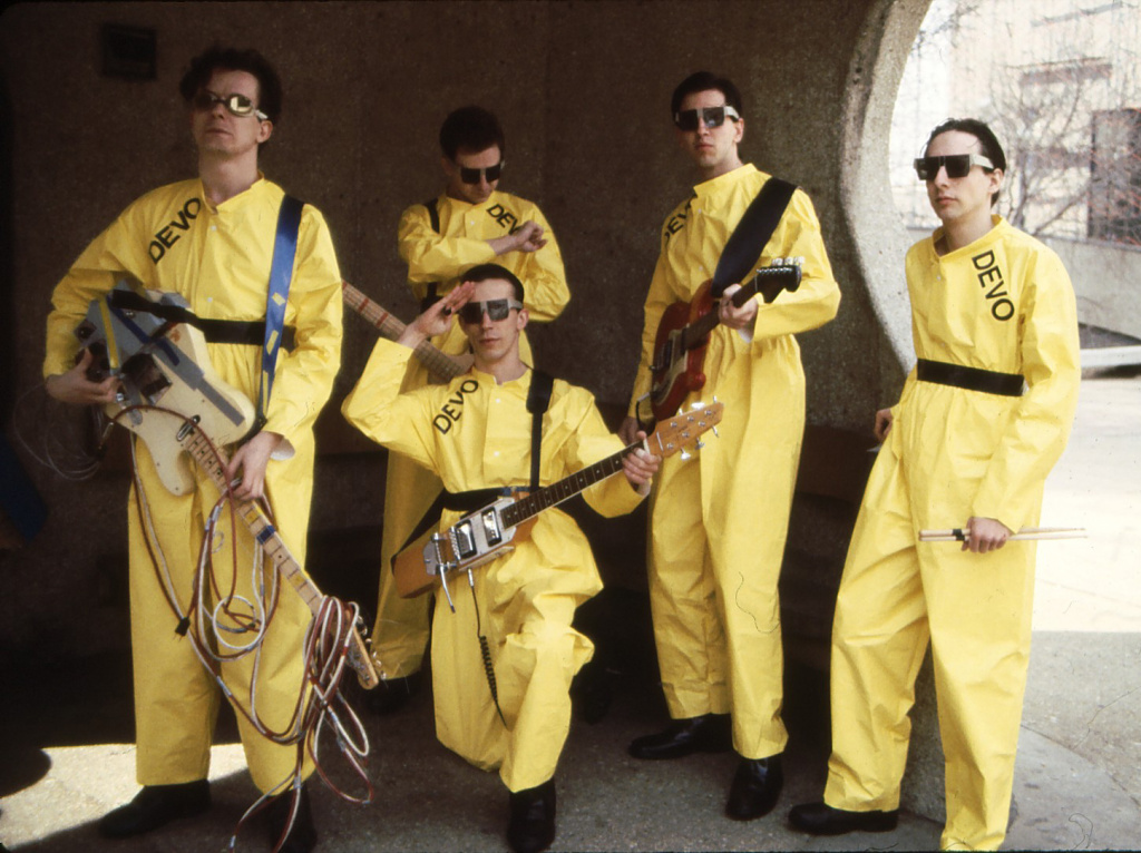 In this 1978 photo taken by Janet Macoska and released by Devo, Inc., the band Devo, from left, Mark Mothersbaugh, Bob Mothersbaugh, kneeling, Jerry Casale, Bob Casale  and Alan Myers pose for a photo.