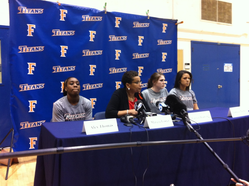 Cal State Fullerton women's basketball coach Marcia Foster (middle), along with players Alex Thomas, Lauren Bushong and Jessica Palmer (L-R) talk with reporters Saturday about assistant coach Monica Quan, who was murdered a week ago in Irvine.