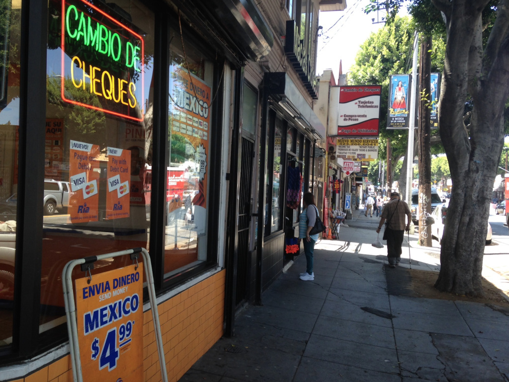 Money wiring businesses on Cesar Chavez Avenue in Los Angeles' Boyle Heights. As the Mexican peso drops, immigrants in the U.S. hope the dollars they send home will help relatives.