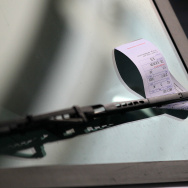 A parking ticket is seen on the windshield of a FedEx truck on January 21, 2011 in San Francisco, California.