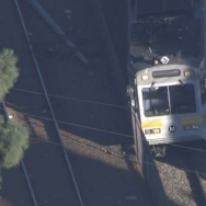 metro train on car collision