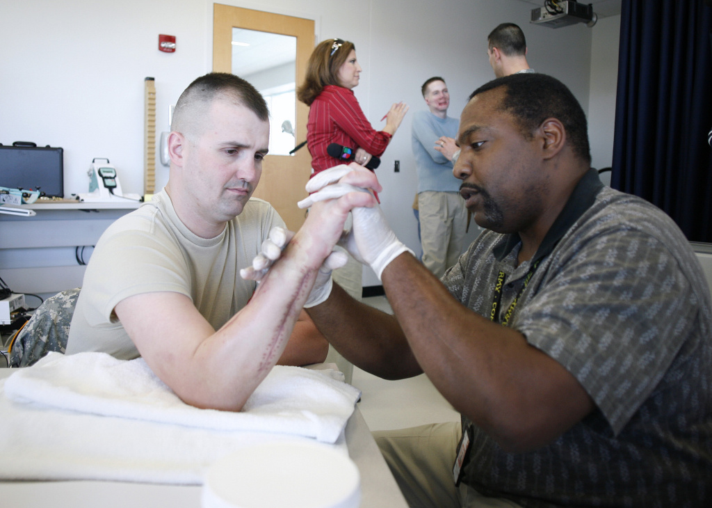 Staff Sgt. Michell Caldwell, 28, works with an occupational therapist at the new high tech Center for the Intrepid rehab center for wounded veterans at Brooke Army Medical Center March 1, 2007 in San Antonio, Texas. That is just one position that requires a professional license