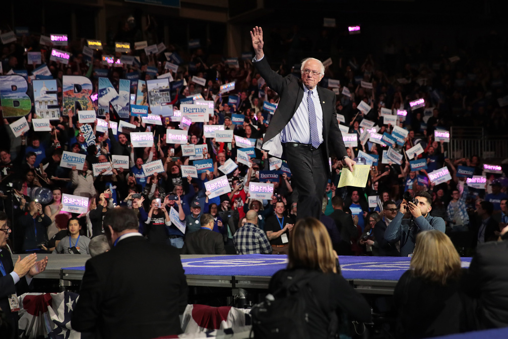 Democratic presidential candidate Sen. Bernie Sanders (I-VT) waves to the crowd during the 100 Club Dinner at SNHIU on February 08, 2020 in Manchester, New Hampshire.