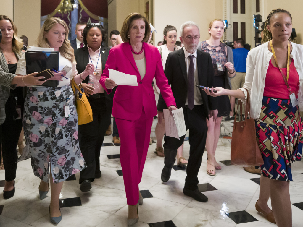 Speaker Nancy Pelosi of California walks to the House floor Thursday. In a letter to Democratic lawmakers she announced the House would