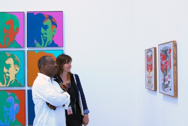 LeVar Burton and Chelsea Beck, The Broad's associate curator for special projects and producer of the audio tours, looking at works by Andy Warhol at The Broad; image courtesy of The Broad