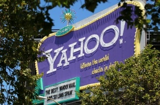 A Yahoo! billboard is visible through trees in San Francisco, California.