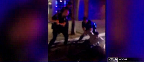 KTLA 5 aired footage of Long Beach police officers subduing a man they say was resisting arrest early Sunday morning.