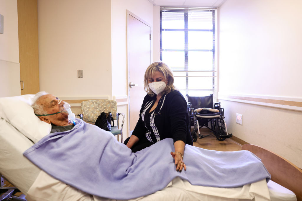 Resident Hanna Nasi is visited by daughter Surab Nasrallah on the first day of in-room family member visits at the Ararat Nursing Facility in the Mission Hills neighborhood on March 24, 2021 in Los Angeles, California.