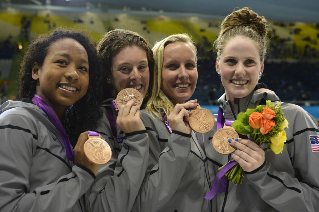 US bronze medallists Missy Franklin (R), Jessica Hardy (2R) , Lia Neal (L) and Allison Schmitt pose with their bronze medals after the women's 4 x 100m freestyle relay swimming event at the London 2012 Olympic Games on July 28, 2012 in London.