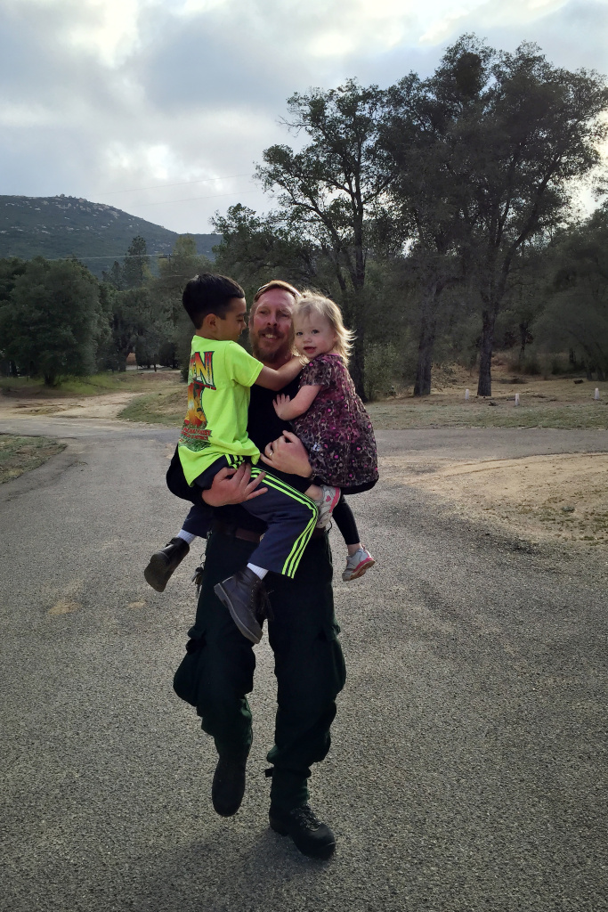 Jim Huston, Superintendent of Laguna Interagency Hotshot Crew at the US Forest Service, grabs his children Thomas, 7, and Hannah, 3. Hotshot crews can spend weeks at a time away from their families.