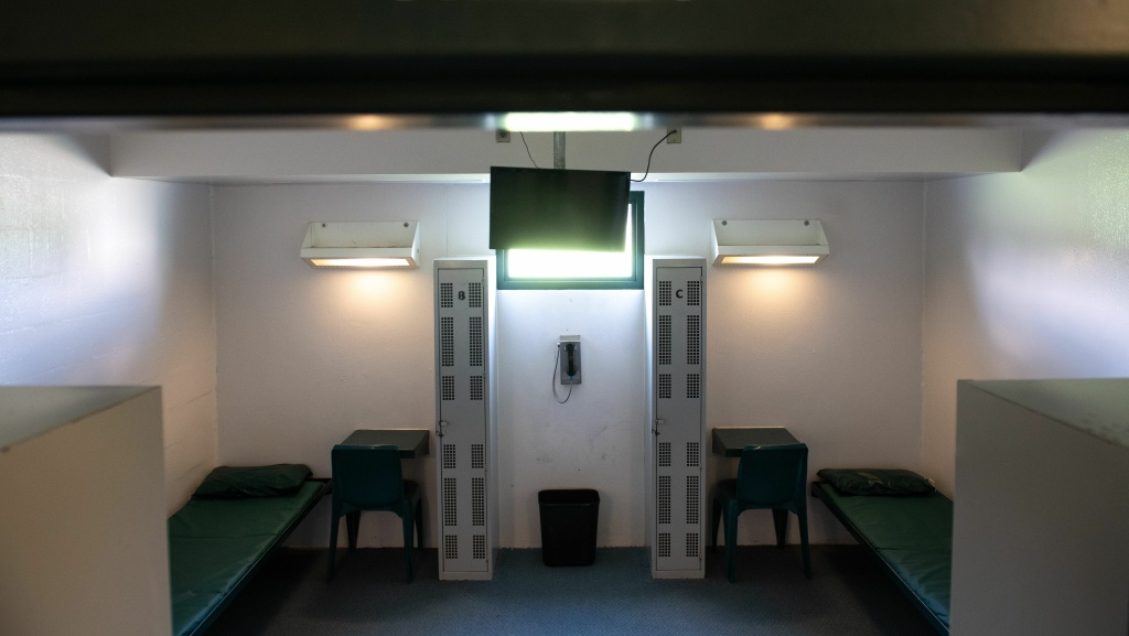 A bunk bed and desks are seen inside a cell at a Virginia detention center contracted by ICE. A Department of Homeland Security inspector general's report found egregious cases of contractors failing to notify ICE of sexual assaults and employee misconduct, among other problems.