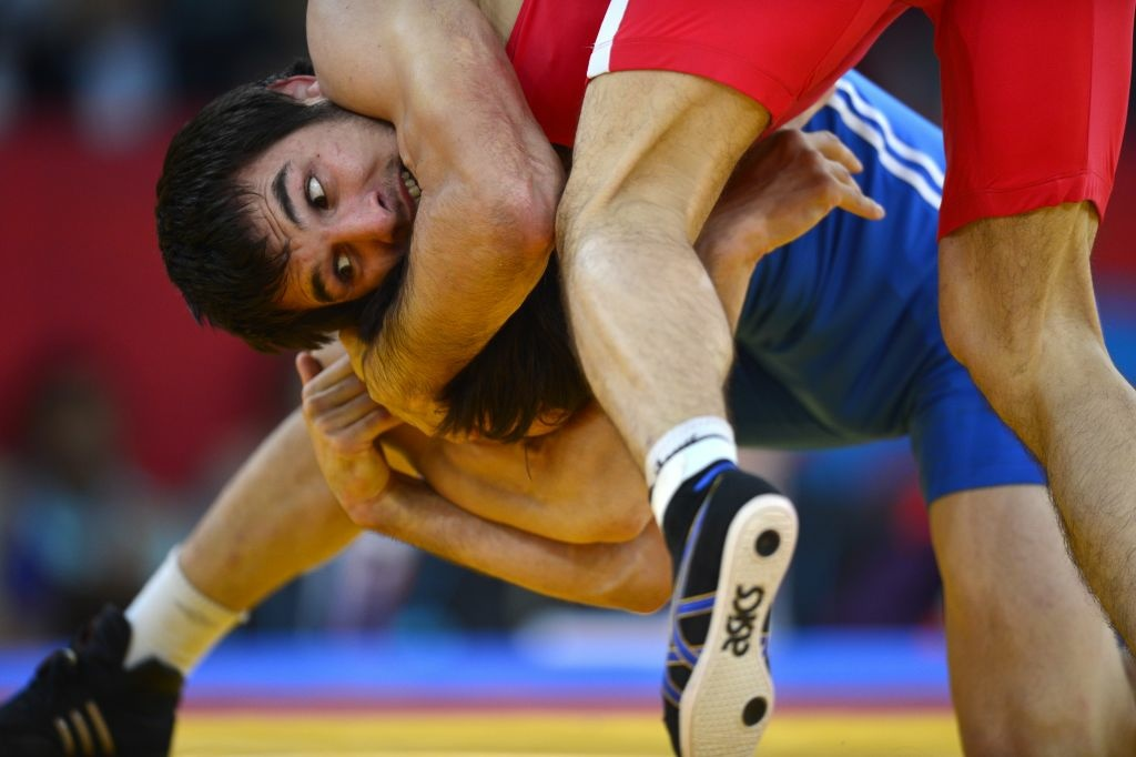 Turkey's Ramazan Sahin (R) wrestles Kazakhstan's Akzhurek Tanatarov in their Men's 66kg Freestyle bronze medal match on August 12, 2012 during the wrestling event of the London 2012 Olympic Games.