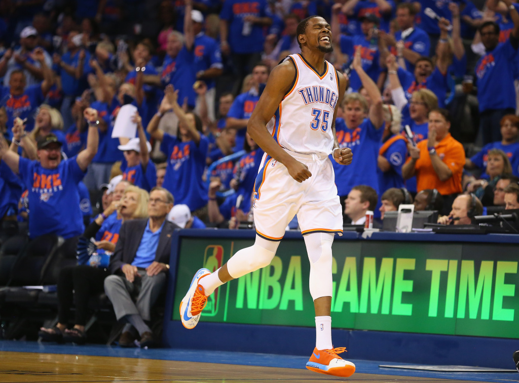 Kevin Durant #35 of the Oklahoma City Thunder celebrates after making a three-point shot against the Memphis Grizzlies in Game Seven of the Western Conference Quarterfinals during the 2014 NBA Playoffs at Chesapeake Energy Arena on May 3, 2014 in Oklahoma City, Oklahoma.