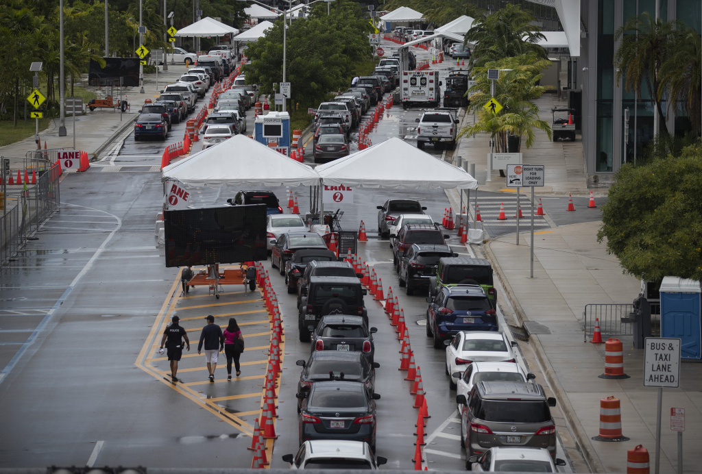 Cars are seen in line as the drivers wait to be tested for COVID-19 at the COVID test site located at the Miami Beach Convention Center on July 13, 2020 in Miami Beach, Florida.
