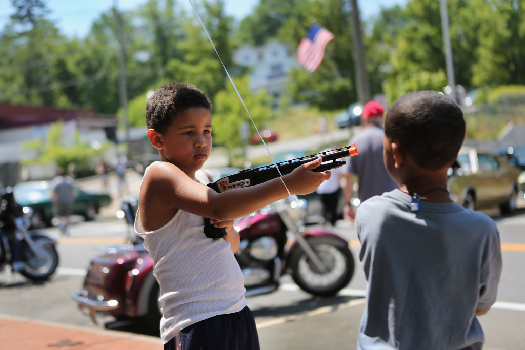 Children play with a toy gun at the Liberty Festival on July 4, 2012 in Liberty, New York.