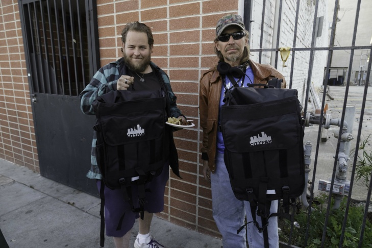 Two Greater West Hollywood Food Coalition clients with their new Citypaks.