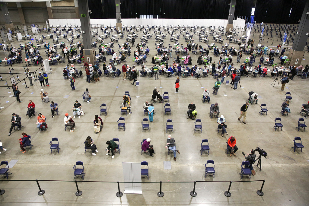 A mass vaccination site at the Lumen Field Event Center in Seattle had plenty of takers for the COVID-19 vaccine when it opened in mid-March. Though some relatively rare cases of coronavirus infection have been documented despite vaccination,
