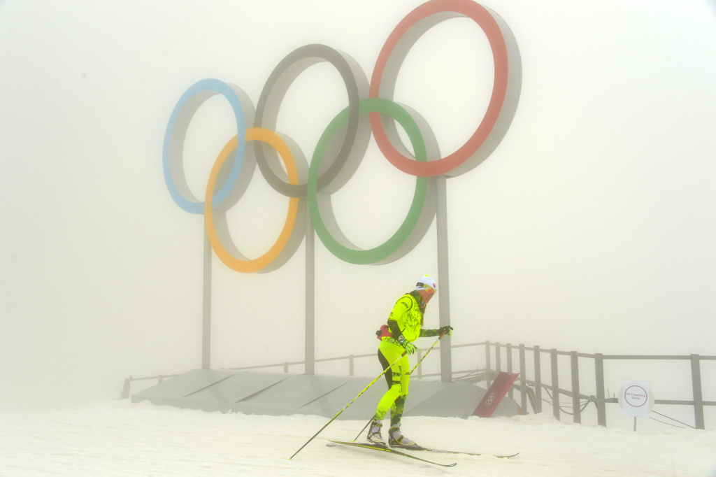 An athlete trains at the Laura Cross-Country Ski and Biathlon Center on February 17, 2014. Thick fog shrouding the mountains at the Sochi Olympics forced organizers to postpone events. Coaches at the Laura biathlon course said the biggest problem was not so much the fog as the poor quality of the snow.