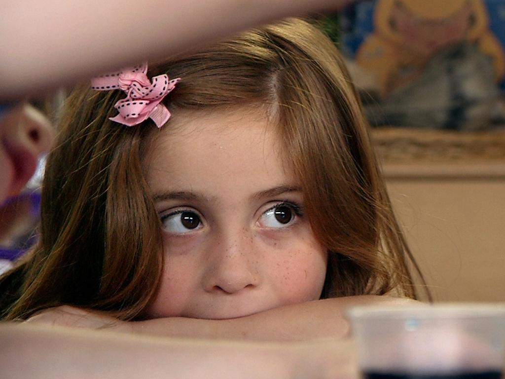 Preschool student Stormy Frazier watches a science experiment unfold in Nikki Jones' classroom in Tulsa, Okla.