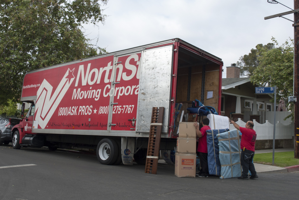 Movers from NorthStar Moving Corporation load a truck with possessions from a newly sold home in Central Los Angeles.