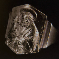 The Fisherman's ring, which Pope Francis will now wear. The name and image honor St. Peter, a fisherman and the first pope. The ring is fashioned in gold-plated silver.
