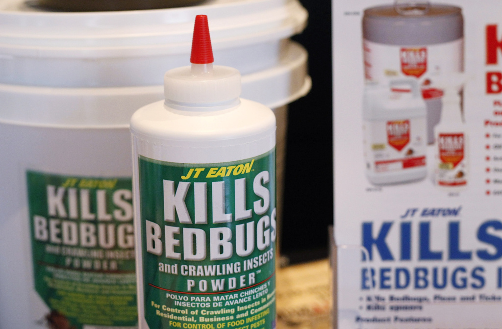 Bedbug insecticide products are displayed at the Bed Bug University North American Summit 2010.